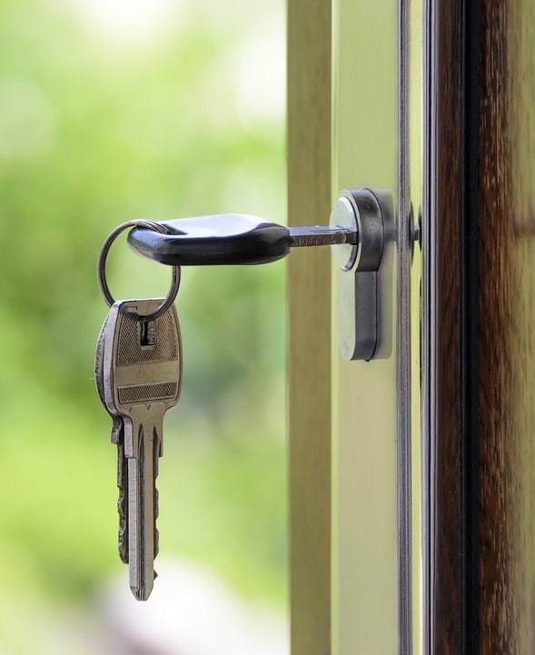 Key opening the door of a Tucson rental property